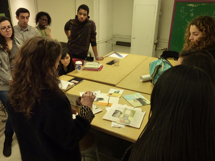 Katherine Streeter presenting or original artwork and tearsheets to students